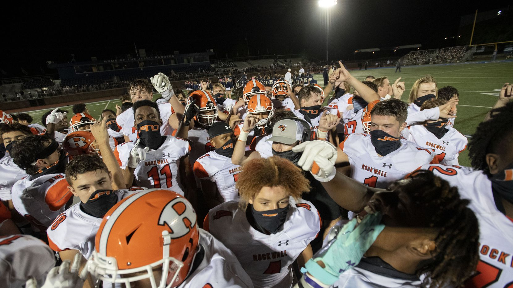 Rockwall players celebrate their 60-38 win over Jesuit in a high school football game on Friday, October 2, 2020 at Postell Stadium in Dallas.