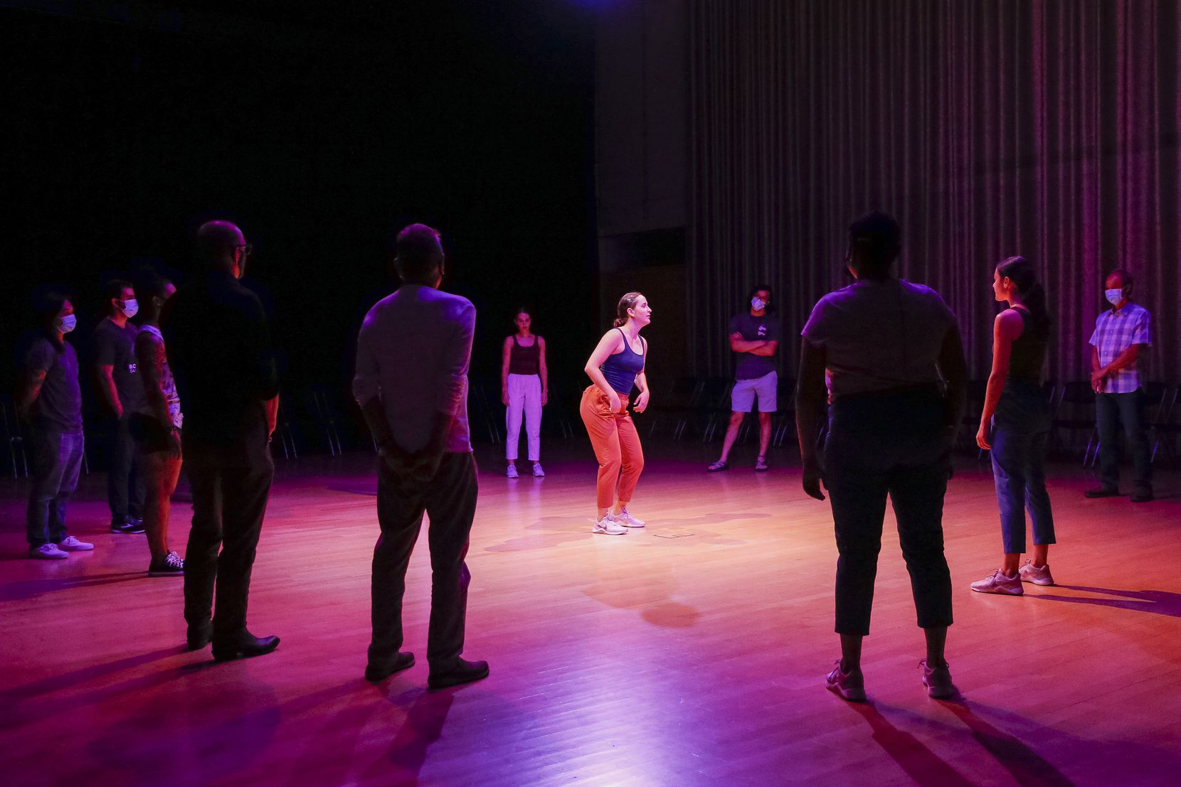 """Lena Oren (center) leads audience members and fellow dancers during a performance of """"The Great 30"""" by Bombshell Dance Project in Hamon Hall."""