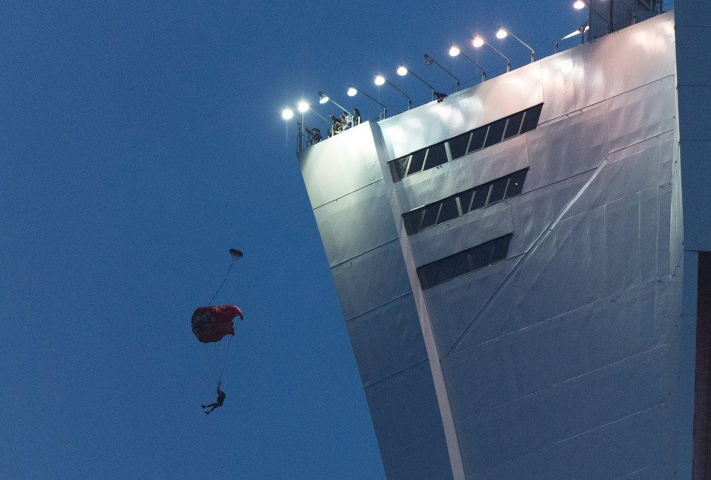 A person parachutes off Olympic Stadium during an MLS soccer match between the Montreal Impact and FC Dallas in Montreal, Saturday, Aug. 17, 2019. (Graham Hughes/The Canadian Press via AP)