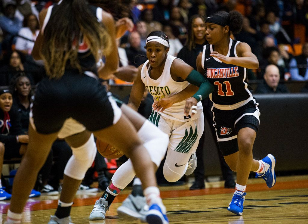 DeSoto's Michayla Gatewood (15) takes the ball past Duncanville's Tristen Taylor (11) during the first quarter of a Class 6A Region I quarterfinal girls basketball game between Duncanville and DeSoto on Tuesday, February 25, 2020 at Wilkerson-Greines Activity Center in Fort Worth. (Ashley Landis/The Dallas Morning News)