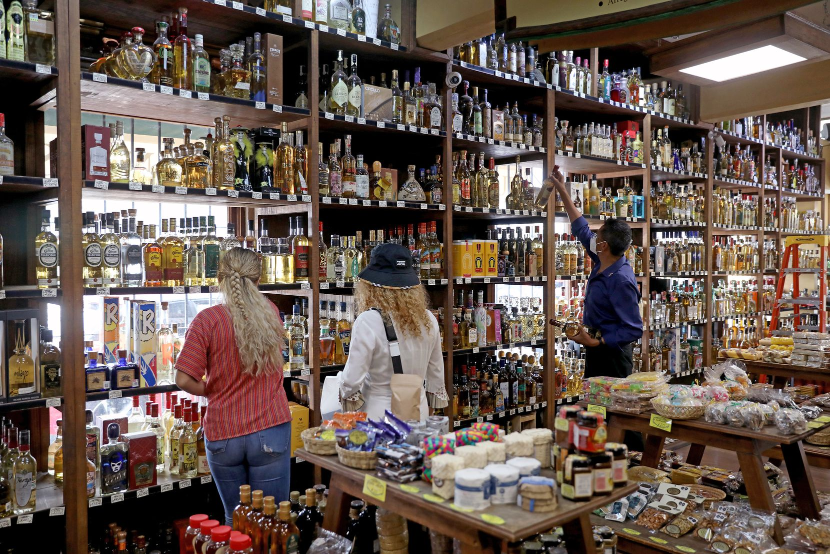 A wide variety of tequila available for sale at Nuestros Dulces store on July 25 in Tlaquepaque, Jalisco.