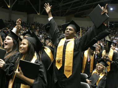 Garland High School graduates celebrate at the end of commencement ceremonies on May 31 at the Curtis Culwell Center in Garland.