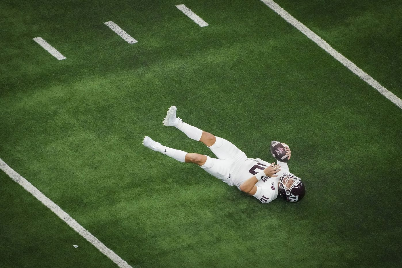 Texas A&M quarterback Zach Calzada (10) slips to the turf during the second half of an NCAA football game against Arkansas at AT&T Stadium on Saturday, Sept. 25, 2021, in Arlington. Arkansas won the game 20-10.
