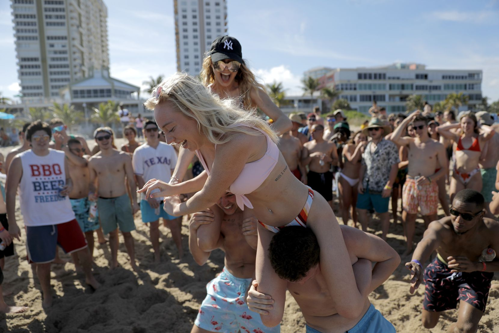 """Spring break revelers watched a """"chicken fight"""" at Pompano Beach, Fla., on Tuesday.  Dr. Anthony Fouci, director of the National Institute of Allergy and Infectious Diseases, called on young vacationers to stop flooding crowded places, for their own protection and that of others."""