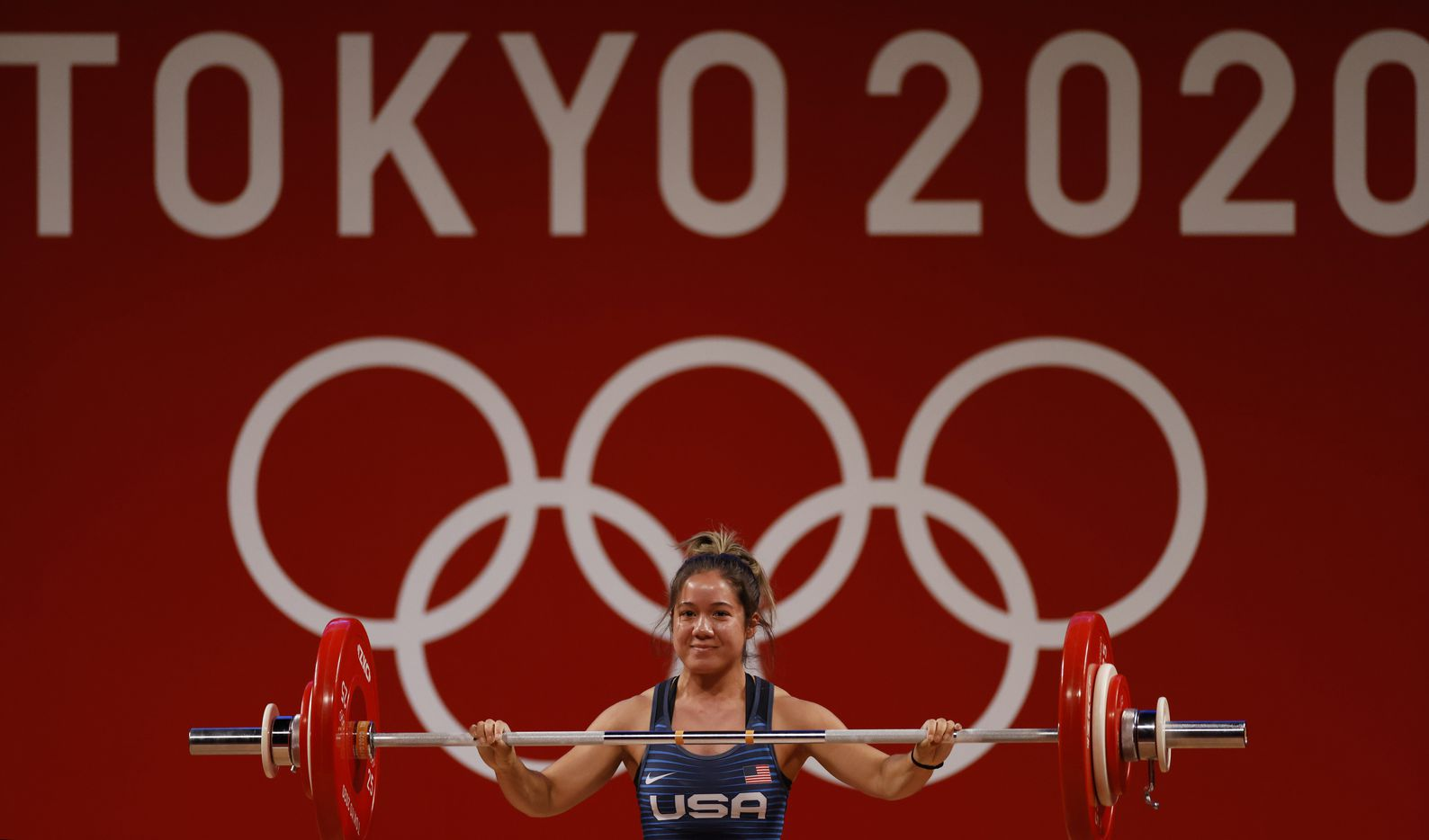 USA's Jourdan Delacruz smiles after lifting 83 kg in the first attempt of the snatch round during the women's 49 kg weightlifting final during the postponed 2020 Tokyo Olympics at Tokyo International Forum on Saturday, July 24, 2021, in Tokyo, Japan. (Vernon Bryant/The Dallas Morning News)