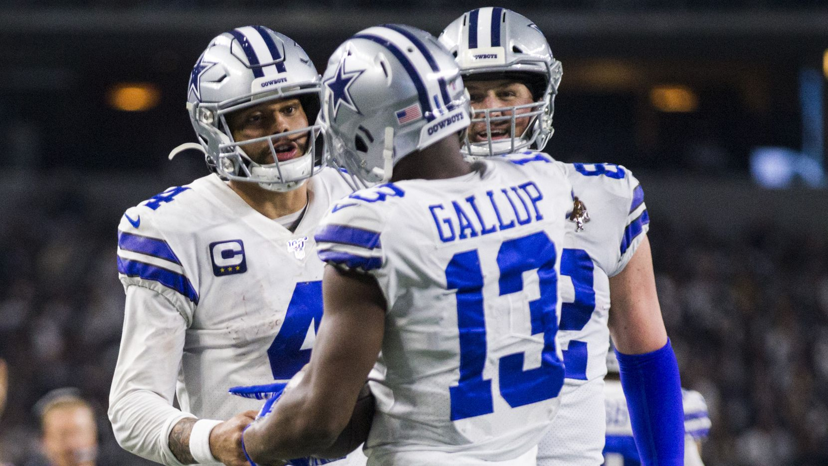 Dallas Cowboys wide receiver Michael Gallup (13) celebrates a touchdown with quarterback Dak Prescott (4) and tight end Jason Witten (82) during the fourth quarter of an NFL game between the Dallas Cowboys and the Washington Redskins on Sunday, December 29, 2019 at AT&T Stadium in Arlington, Texas.