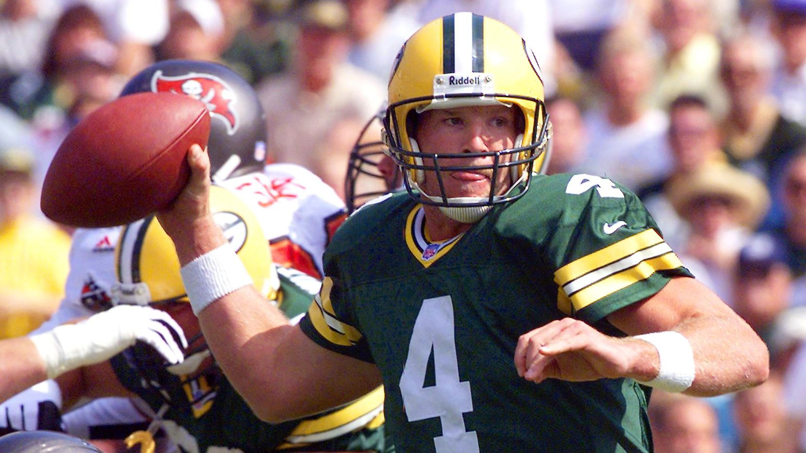 FILE: In this September 13, 1998 file photo, quarterback Brett Favre of the Green Bay Packers throws under pressure against the Tampa Bay Buccaneers during the first half of their game at Lambeau Field, in Green Bay, Wisconsin.