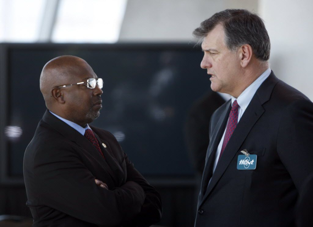 Dallas City Council member Tennell Atkins (left) speaking with Mike Rawlings.