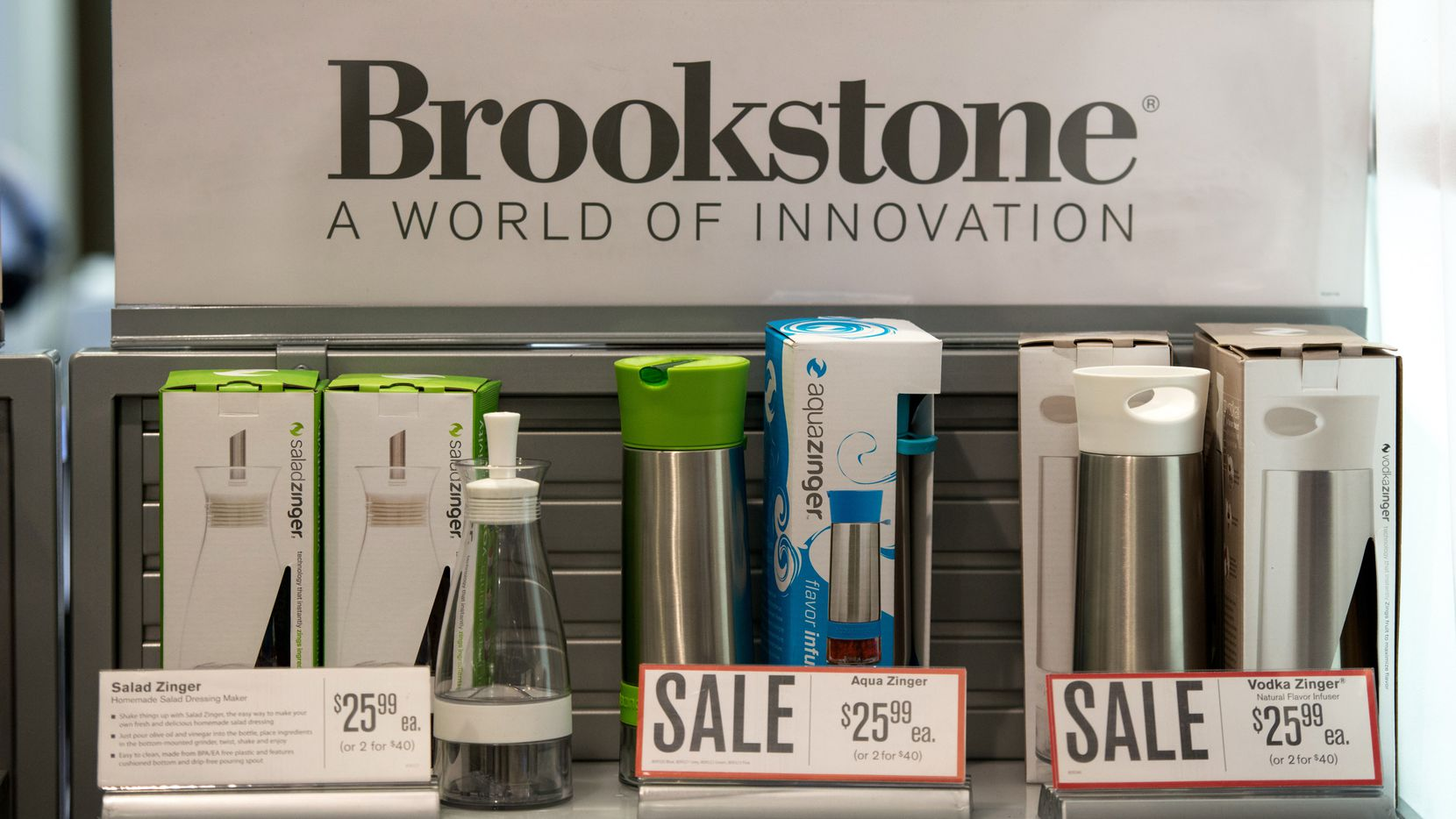 Items are displayed for sale in a Brookstone Inc. store in the concourse of Rockefeller Center in New York, U.S., on Wednesday, April 2, 2014. Brookstone Inc., the retailer of gadgets such as virtual keyboards and personal drones, sought bankruptcy protection to pursue a sale to Spencer Spirit Holdings Inc. as online competitors cut into its business and consumers spend less on non-essentials. Photographer: Craig Warga/Bloomberg