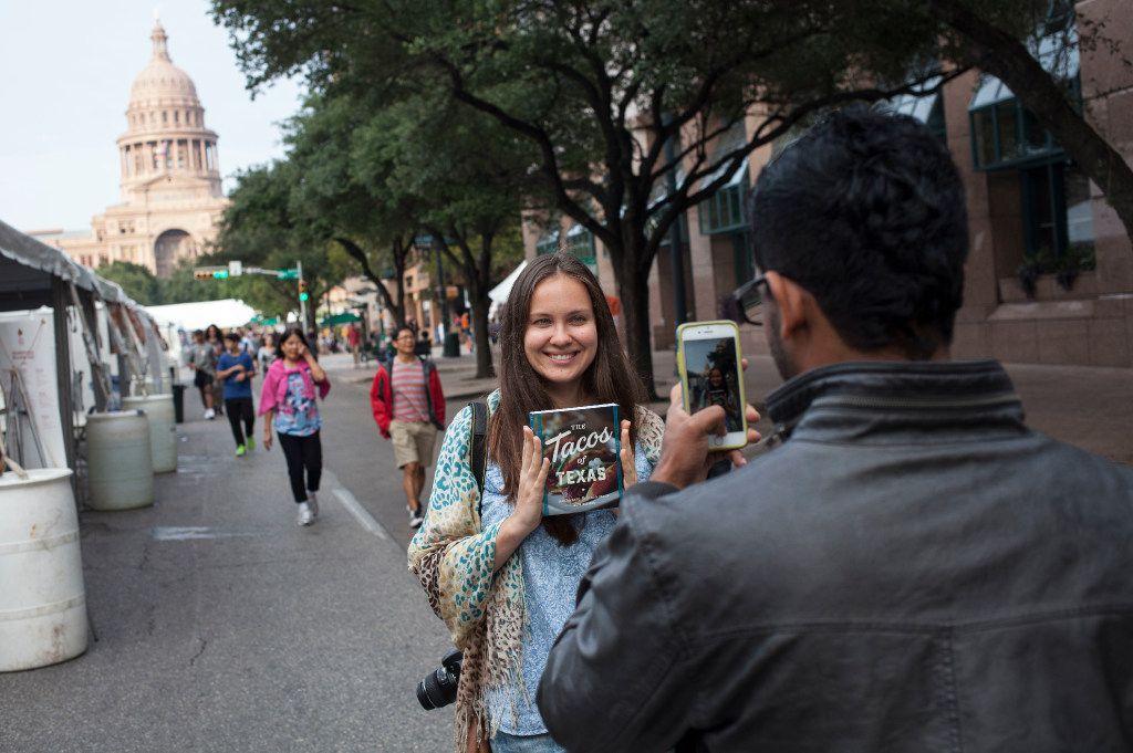 Yulia Dyukova has her photo taken by Isuru Fernando on Congress Avenue in Austin during the Texas Book Festival  on Nov. 5, 2017.