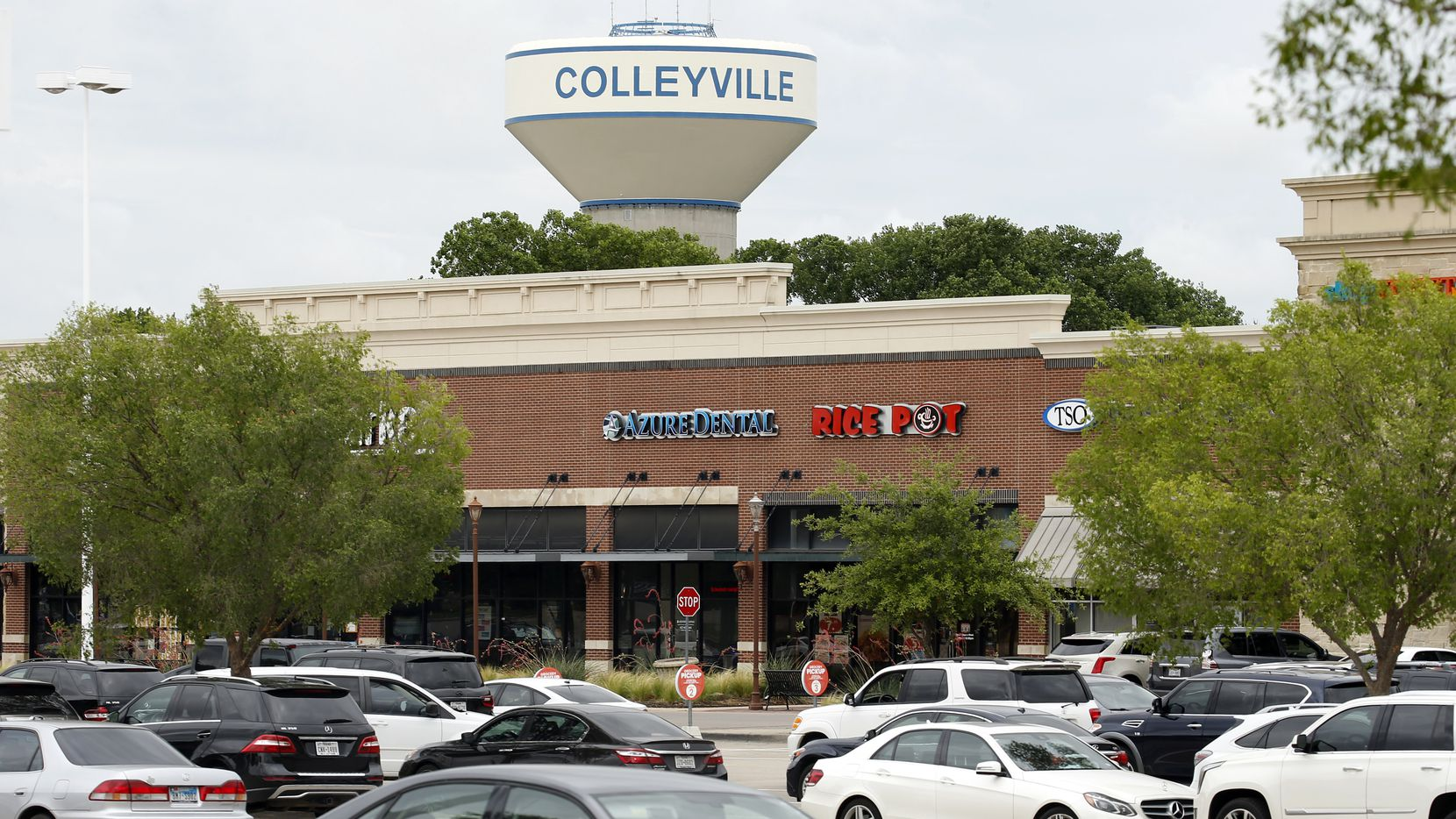 A Colleyville water tower is pictured near a shopping center in this June file photo. Mayor Richard Newton recently announced that he received his first dose of the COVID-19 vaccine, saying that he hoped other Colleyville residents will follow suit.