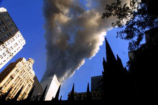 Smoke spews from a tower of the World Trade Center September 11, 2001 after two hijacked airplanes hit the twin towers in a terrorist attack on New York City.