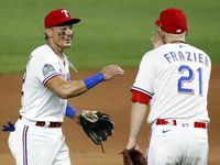 Rangers second baseman Derek Dietrich (32) is congratulated on his good game by teammate Todd Frazier (21) after their 7-4 comeback win against the Seattle Mariners at Globe Life Field in Arlington on Wednesday, Aug. 12, 2020.