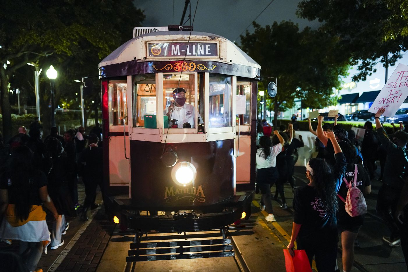 Demonstrators march around a stopped M-Line Trolley after blocking the intersection of  McKinney at Pearl as they march through the Uptown after a Kentucky grand jury brought no charges against Louisville police for the killing of Breonna Taylor on Wednesday, Sept. 23, 2020.