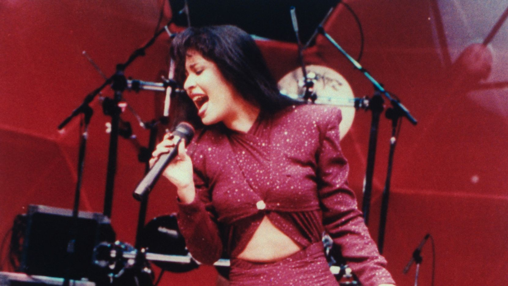 Selena is shown performing in concert; one month later she would be shot and killed by Yolanda Saldivar, the president of her fan club, after confronting her on charges that she was embezzling funds. (Photo by Arlene Richie)