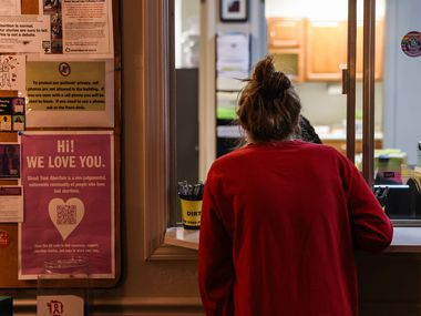 Cassidy, a woman who traveled from Texas and prefers to be identified only by her first name, checks out at the front desk after a procedure at Hope Medical Group for Women in Shreveport, La., on Tuesday. The clinic assists women with unintended pregnancies including women from Texas state.