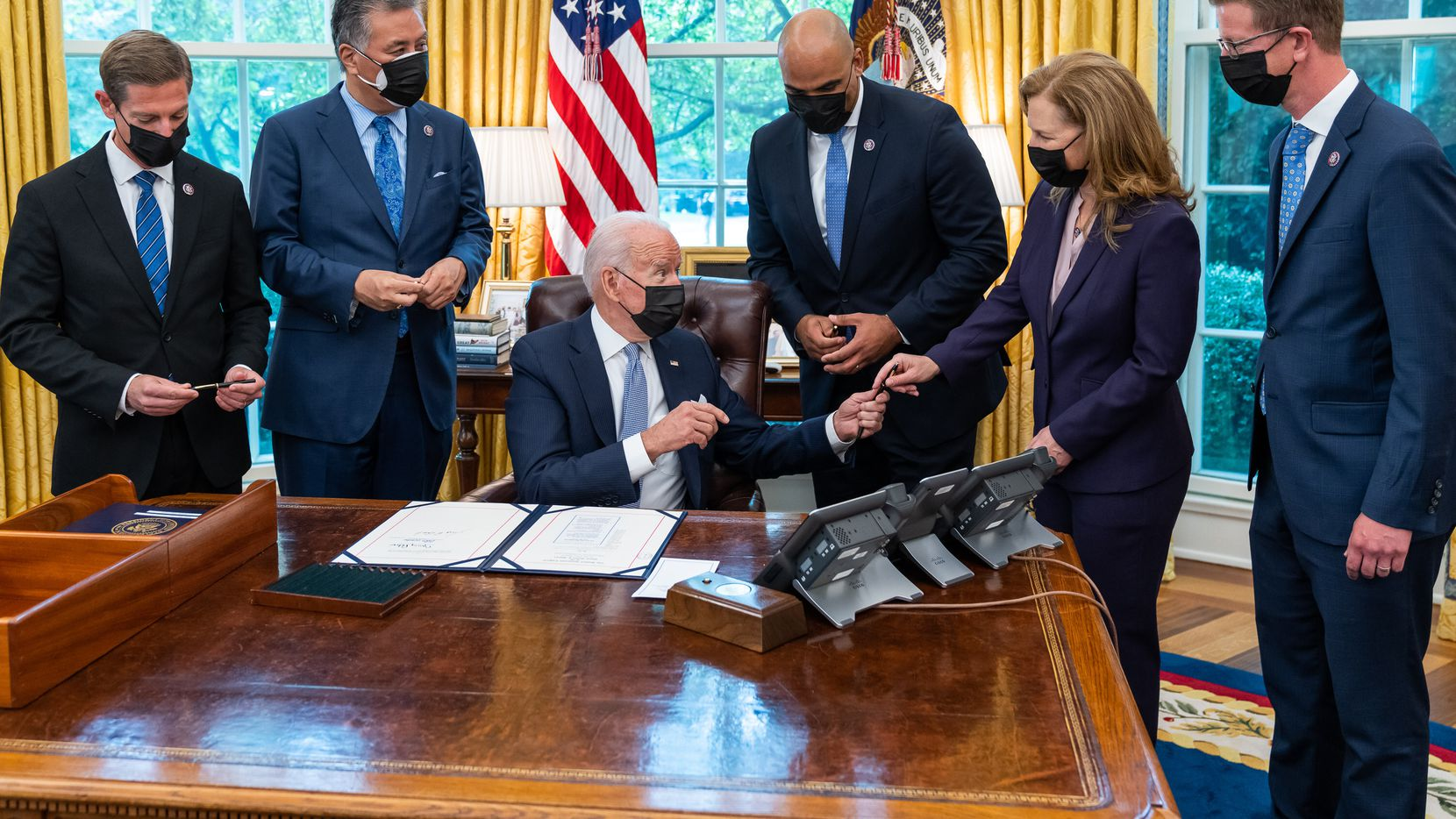President Joe Biden, joined by members of Congress, signs the Major Medial Facility Authorization Act of 2021, Thursday, July 29, 2021, in the Oval Office of the White House. (Official White House Photo by Adam Schultz)