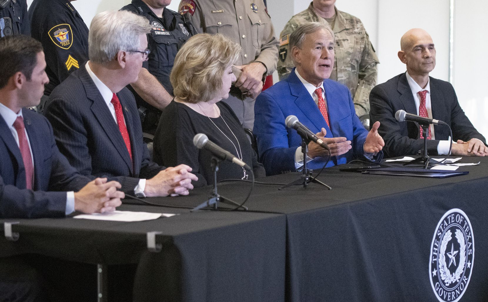 Texas Governor Greg Abbott, answers a question at a press conference where he signed HB9 into law at the Fort Worth Police Officers Association headquarters on Friday September 17, 2021. Joining Abbott at the press conference were, from left, FWPOA President Manny Ramirez, Lieutenant Governor Dan Patrick, Senator Jane Nelson and Representative Greg Bonnen, (Robert W. Hart/Special Contributor)