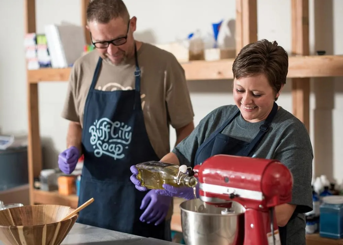 Buff City Soap founder Brad Kellum (left) is now in a product development role creating new soaps for the company. The retail soap chain is moving its headquarters from Memphis to Dallas.
