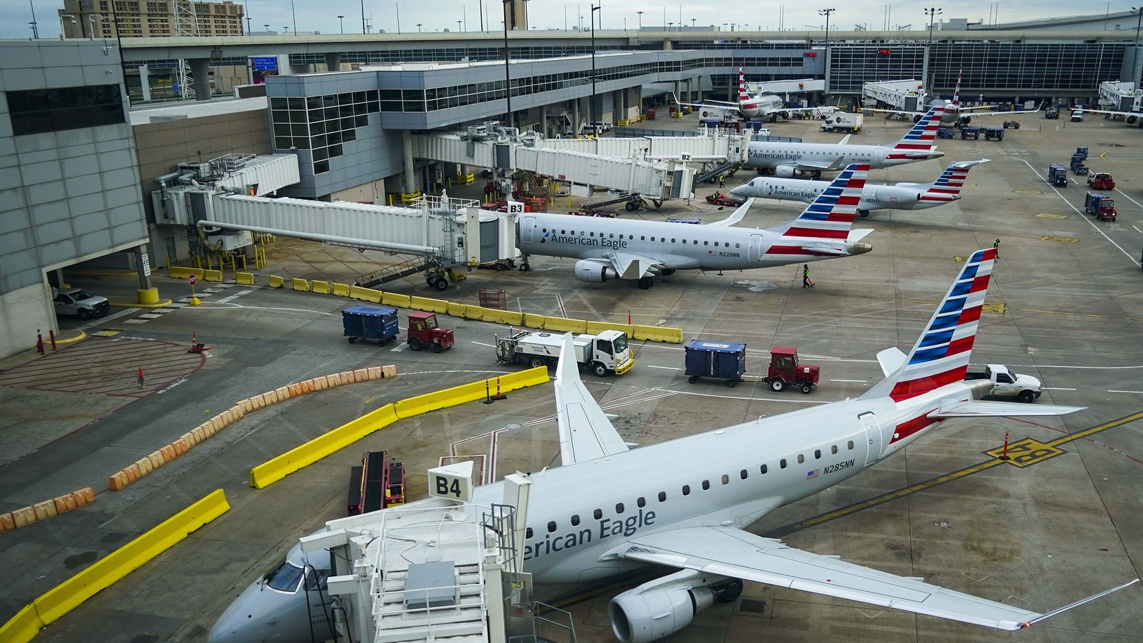 American Eagle planes parked at their gates at  Dallas Fort Worth International (DFW) Airport Terminal B on Friday, March 20, 2020.