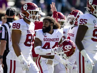 Oklahoma defensive back Brendan Radley-Hiles (44) and his teammates take the field during an NCAA college football game against TCU, Saturday, Oct. 24, 2020, in Fort Worth, Texas. Oklahoma won 33-14. (AP Photo/Brandon Wade)