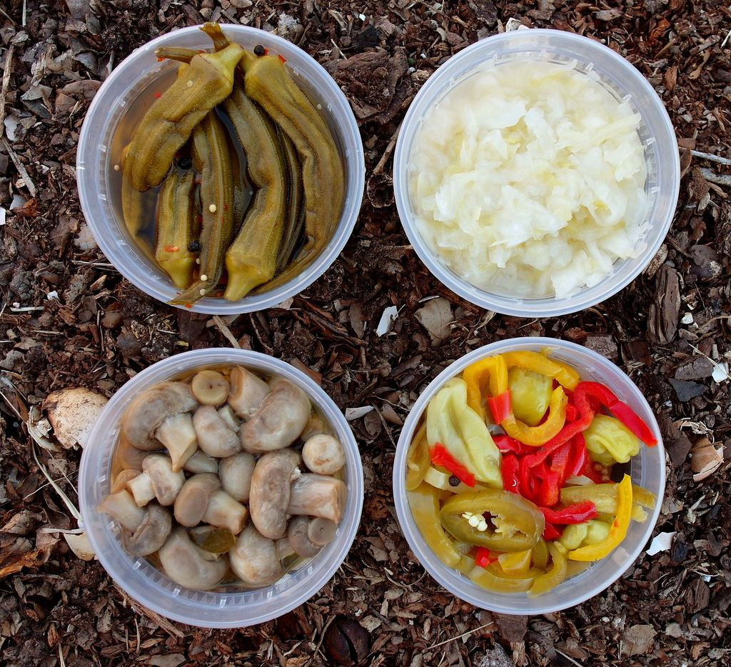 Pickletopia is all about fresh, pickled foods, including (clockwise from top left) sweet-and-sour okra, traditional German sauerkraut, giardiniera and mushrooms.