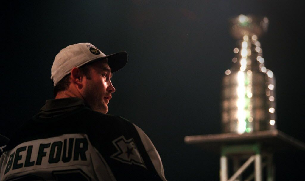 Dallas goalie Eddie Belfour enjoys the festivities on stage during the Stanley Cup celebration at Reunion Arena in June 1999.