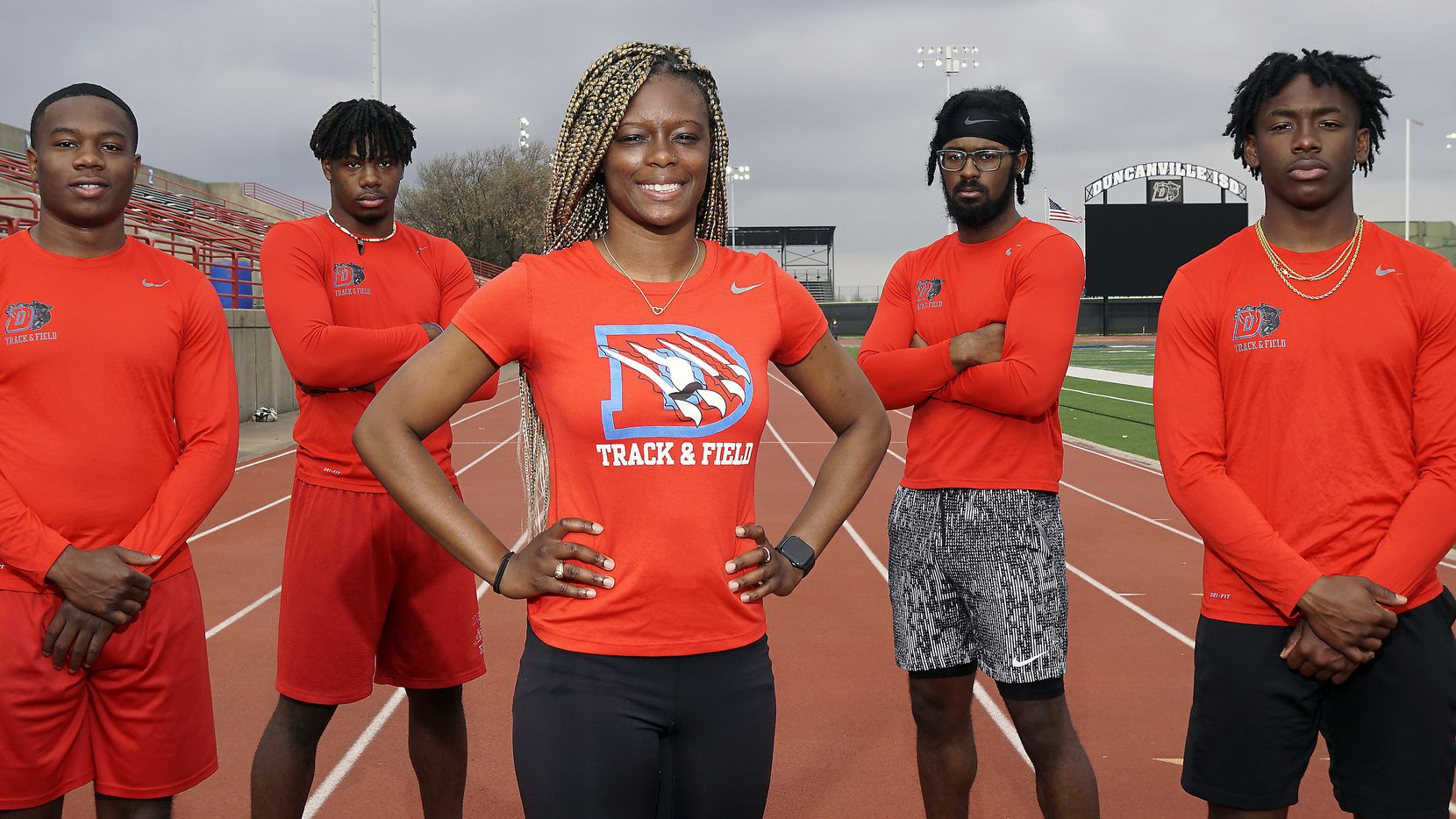 Duncanville boys sprint coach LaKeidra Stewart (center) is flanked by her 4x100 team, from left, Roderick Daniels Jr., Pierre Goree, Elijah Keeton and Donte Hamilton. Duncanville has run 40.96, the third-best time in the nation. (Lawrence Jenkins/Special Contributor)