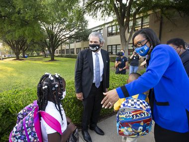 Dallas ISD Superintendent Dr. Michael Hinojosa and Dallas Mavericks CEO Cynt Marshall welcome students on the first day of school at Adelle Turner Elementary School in Dallas, Monday, August 9, 2021. (Brandon Wade/Special Contributor)