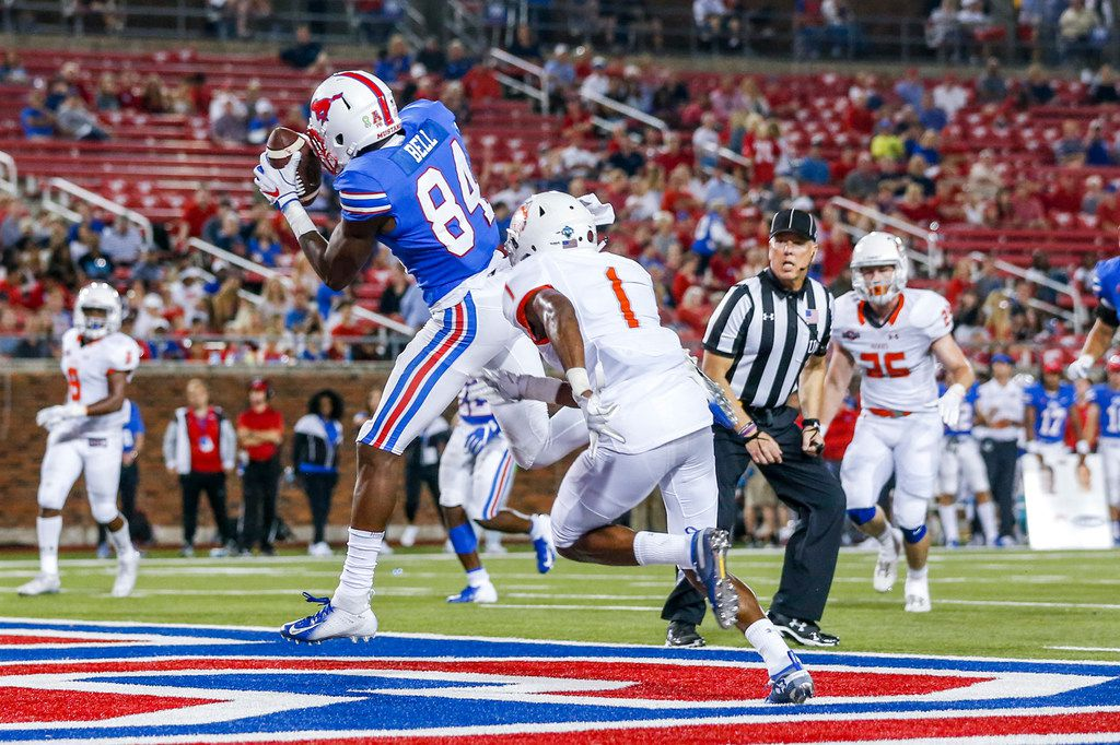 Southern Methodist Mustangs wide receiver Judah Bell (84) makes a touchdown pass against Houston Baptist Huskies cornerback Raphael Lewis (1) during the first half of an NCAA football game between Southern Methodist Mustangs and Houston Baptist on Saturday, September 29, 2018 at Ford Stadium in Dallas. (Shaban Athuman/The Dallas Morning News)