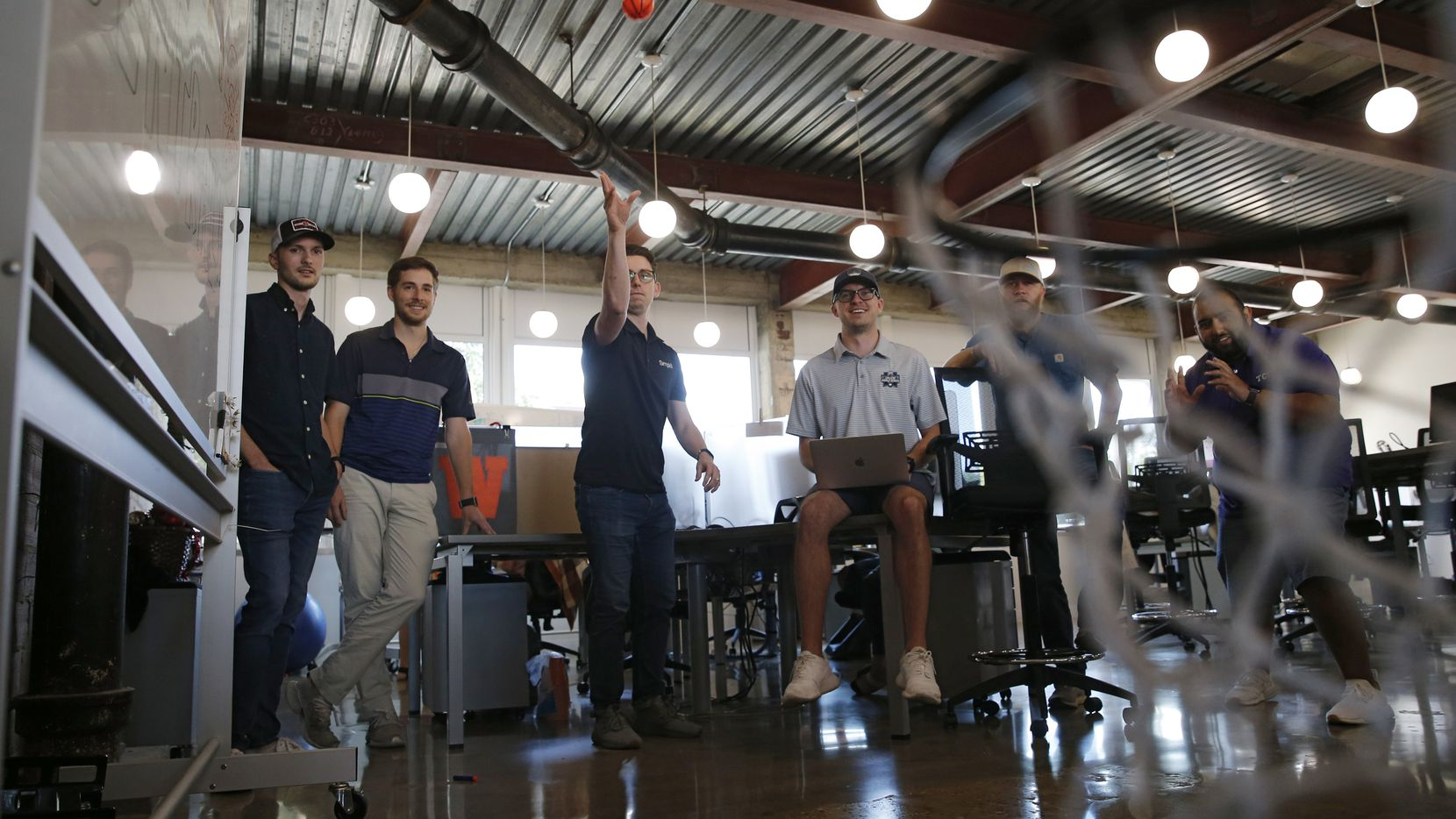 Jack Sperco takes a shot during a game of basketball at Simpli.fi in Fort Worth.