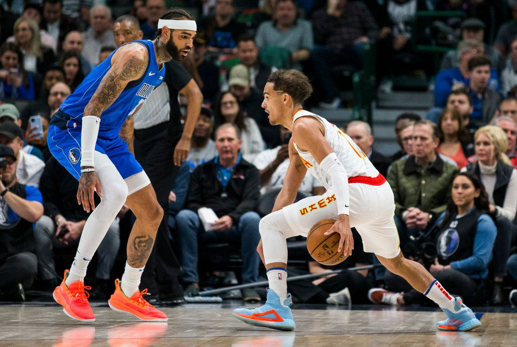 FILE - Hawks guard Trae Young (11) tries to get around Mavericks center Willie Cauley-Stein (33) during the first quarter of a game on Saturday, Feb. 1, 2020, at American Airlines Center in Dallas.