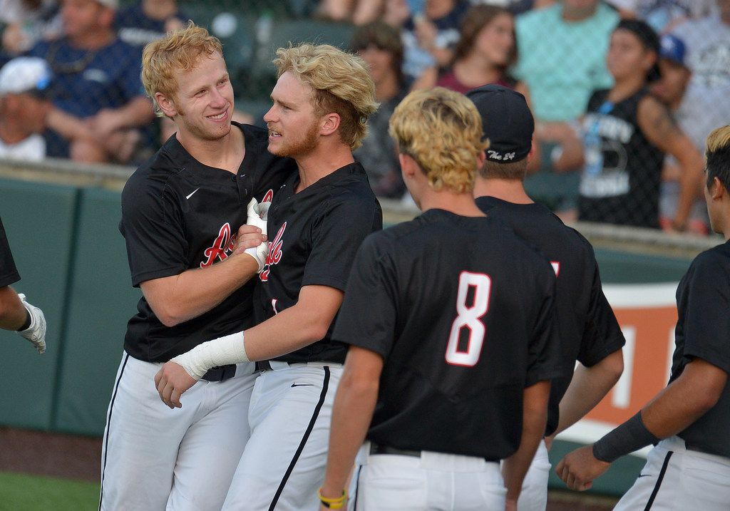 Argyle Eagles shortstop Brenden Dixon (5) celebrating with Argyle Eagles centerfielder Dillon Carter (1) after being walk to home plate during the UIL Class 4A state championship game between the Sweeny Bulldogs and the Argyle Eagles at UFCU Disch-Falk Field in Austin, Texas, Thursday, June 7, 2018. Argyle defeated Sweeny, 5-0 winning the Class 4A state championship game. (Patrick Green/DRC)