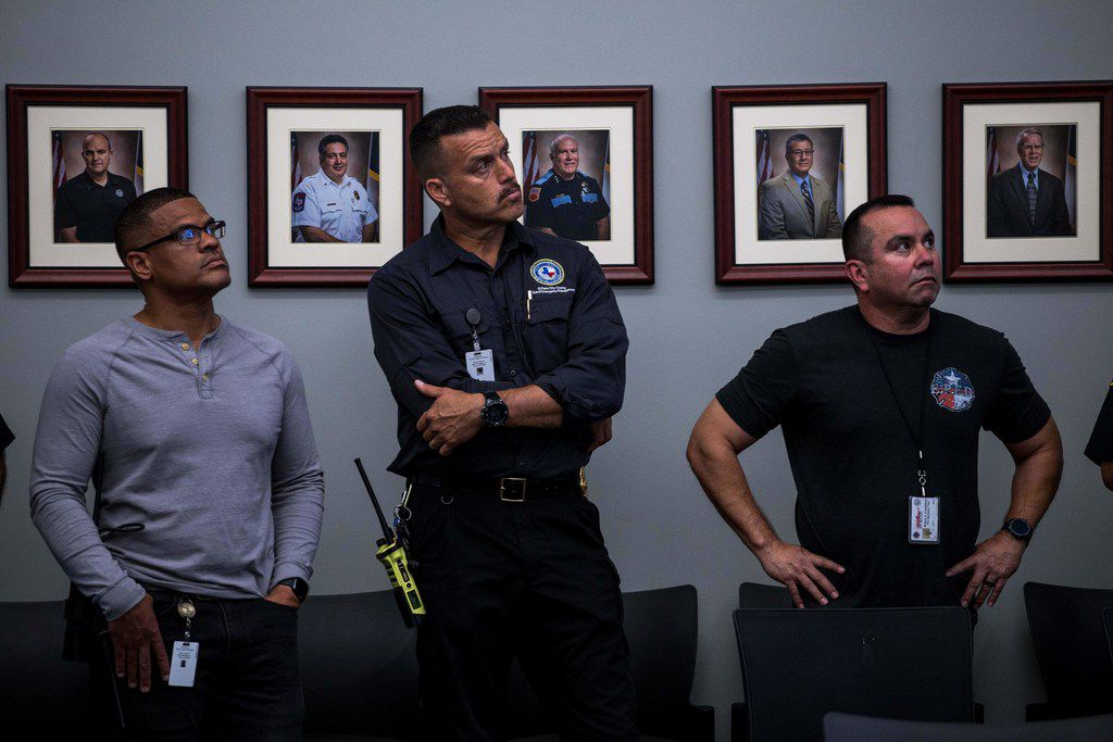 Law enforcement agents listens during a press briefing, following a mass fatal shooting, at the El Paso Regional Communications Center in El Paso, Texas, on August 3, 2019. - A gunman armed with an assault rifle killed 20 people Saturday when he opened fire on shoppers at a packed Walmart store in the latest mass shooting in the United States. (Photo by Joel Angel JUAREZ / AFP)JOEL ANGEL JUAREZ/AFP/Getty Images