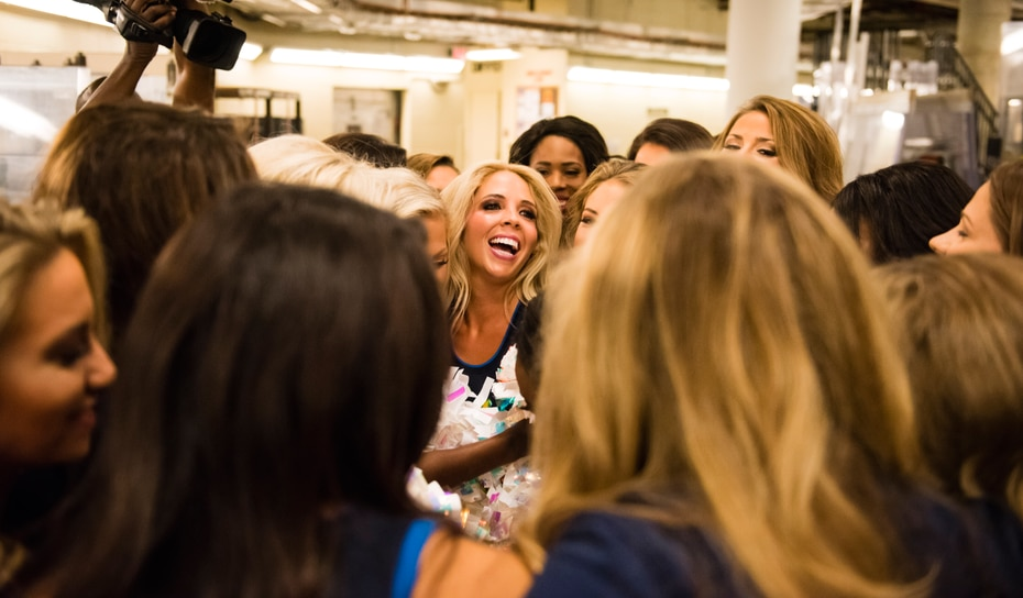 Here's me, Kimber Westphall, getting a group hug before the Mavs Dancers and I hit the court.