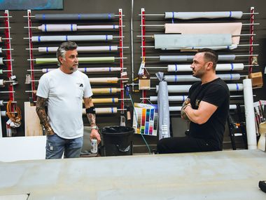 Richard Rawlings, left, is collaborating with Cameron Davies, right, to build what they call a 'killer' food truck that's 42 feet long and can serve 10,000 people per day. The truck will be parked at Gas Monkey Garage in Dallas.