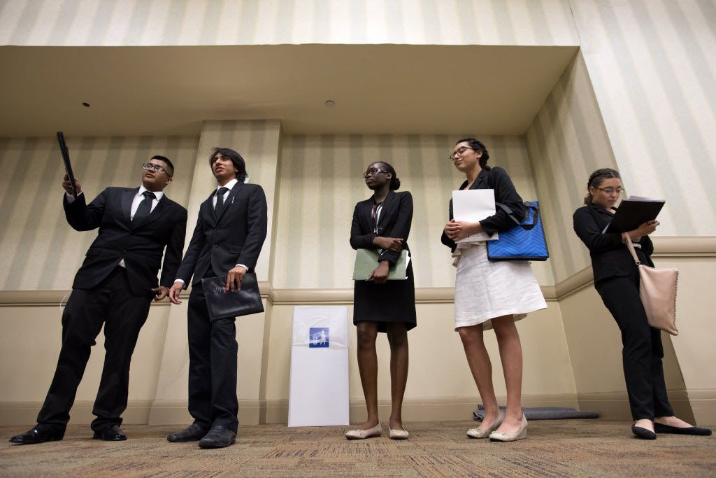 High school students Andres Verastegui, 16, Erik Angeles, 17, Rebecca Lado, 16, Christine Gallegos, 16, and Katherine Galvez, 17, left to right, take a break from interviews during the Mayor's Intern Fellows Program job fair Friday, April 8, 2016 at the Hyatt Regency Hotel in downtown Dallas. Over 900 Dallas public and charter high school students competed for nearly 400 paid summer internships offered by Dallas area businesses. (Jeffrey McWhorter/Special Contributor)