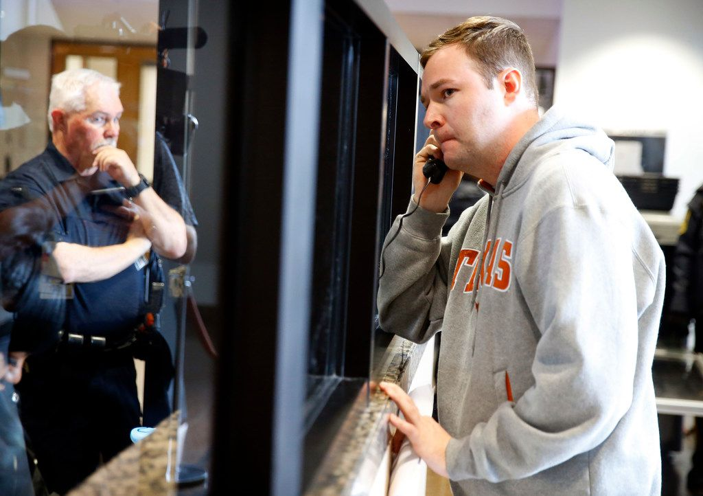 Austin Shuffield, 30, calls for a ride from the Frank Crowley Courthouse after he was released on a $1000 bond, Friday, March 29, 2019.  Shuffield was booked into the Dallas County Jail about 8:15 a.m. Friday on an unlicensed-weapon charge, one of four misdemeanors he faces, along with assault, interfering with an emergency call and public intoxication. The latest arrest warrant for Shuffield reveals that police believe he pulled out a gun during his argument with L'Daijohnique Lee, just before the March 21 fight.