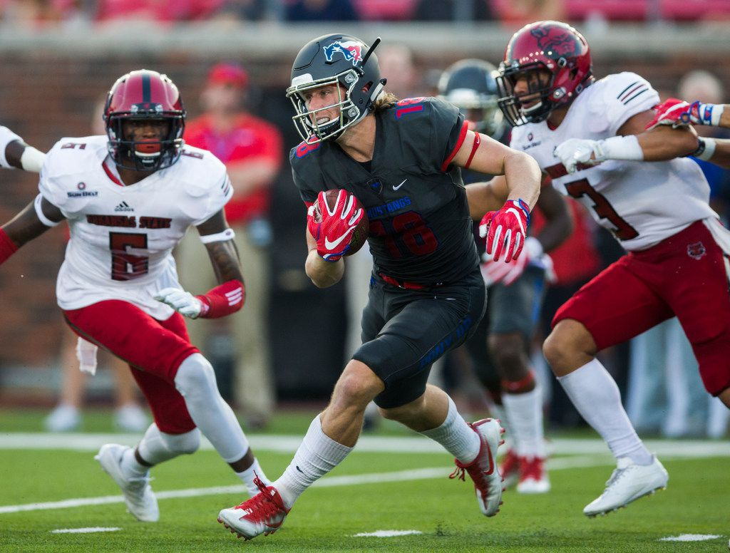Southern Methodist Mustangs wide receiver Trey Quinn (18) runs the ball during the first quarter of a game between Arkansas State and SMU on Saturday, September 23, 2017 at Ford Stadium on the SMU campus in Dallas. (Ashley Landis/The Dallas Morning News)