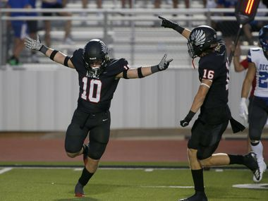 Argyles Will Ramsey (10) celebrates his interception against Decater with Jacob Robinson (16) during a high school football game in Argyle, Tx, on August 28, 2020.      ORG XMIT: Argyle23