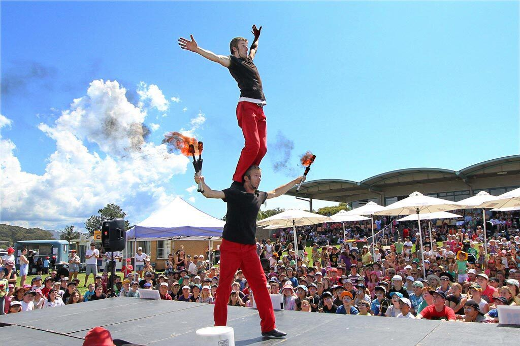 """For 2021, Grapevine presents Main Street Fest """"Reimagined,"""" a street festival featuring European-style theatrical street performances, live music on three stages and the Craft Brew Experience. Pictured is """"The Red Trouser Show,"""" which includes balancing and juggling."""