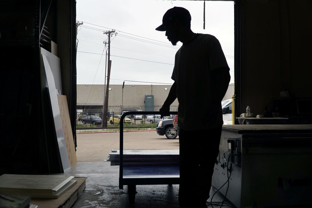 An Irving plastics company hit the big time in March when orders for plastic shields and barriers began flooding in. So why do the owners feel guilty?