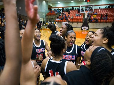Duncanville celebrates a 47-43 win after a Class 6A Region I quarterfinal girls basketball game between Duncanville and DeSoto on Tuesday, February 25, 2020 at Wilkerson-Greines Activity Center in Fort Worth.