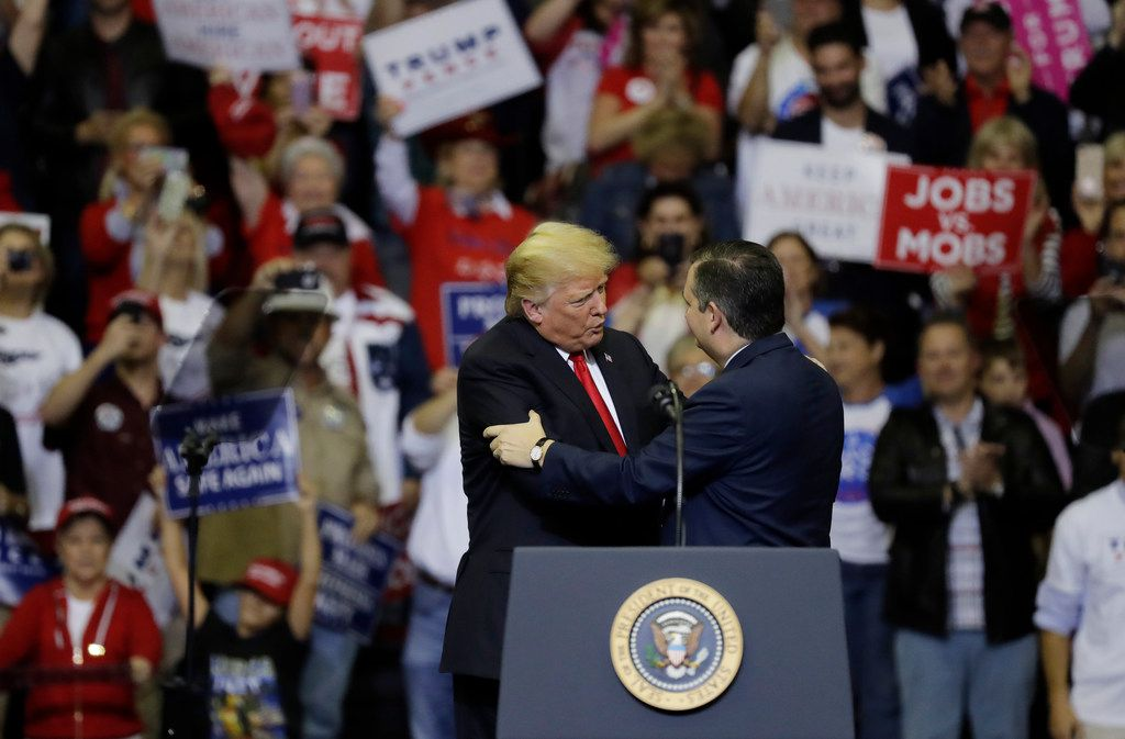 President Donald Trump, left, embraces Sen. Ted Cruz, R-Texas, during a campaign rally, Monday, Oct. 22, 2018, in Houston. (AP Photo/Eric Gay)