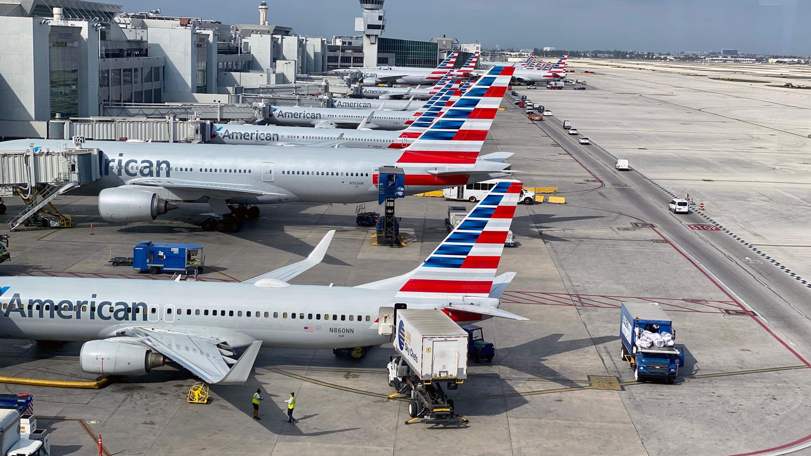 (FILES) In this file photo taken on March 03, 2020 American Airlines planes are seen at Miami International Airport (MIA) in Miami, Florida.  (Photo by DANIEL SLIM/AFP via Getty Images)
