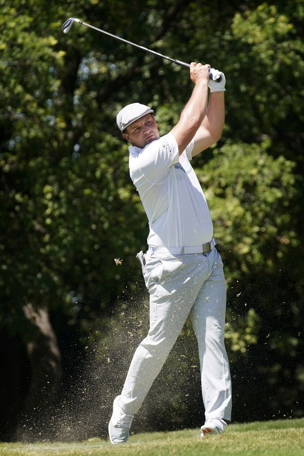 PGA Tour golfer Bryson DeChambeau follows through on his iron shot on the No. 9 tee during the second round of the Charles Schwab Challenge at the Colonial Country Club in Fort Worth, Friday, June 12, 2020.  The Challenge is the first tour event since the COVID-19 pandemic began. (Tom Fox/The Dallas Morning News)