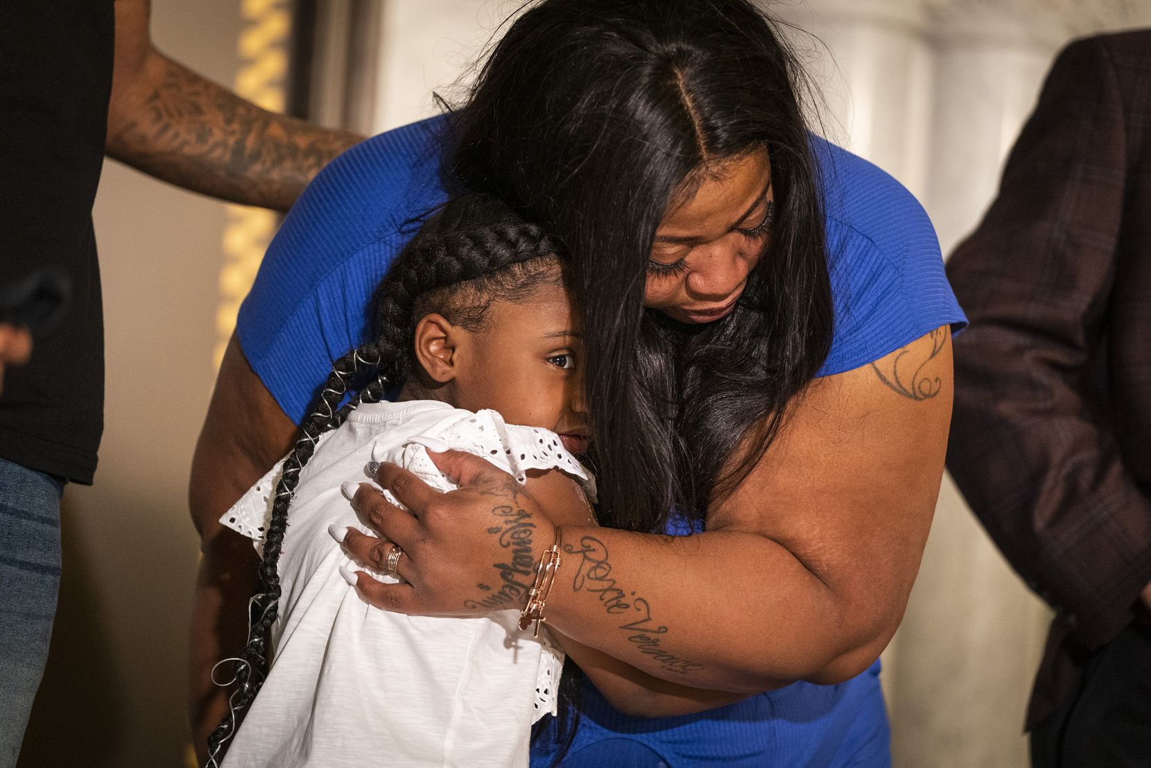 Gianna Floyd hugged her mother, Roxie Washington, during a June 2 news conference in Minneapolis.