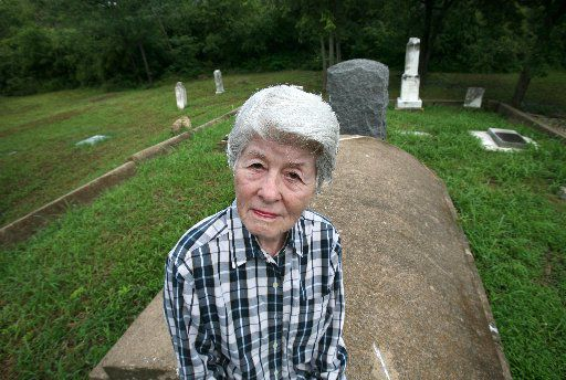 Frances James became the unofficial guardian of the Garvin Memorial Cemetery near Bachman Lake and believed that the cemetery contains at least 30 unmarked graves. James led city efforts to get development controls on privately owned property near the cemetery.