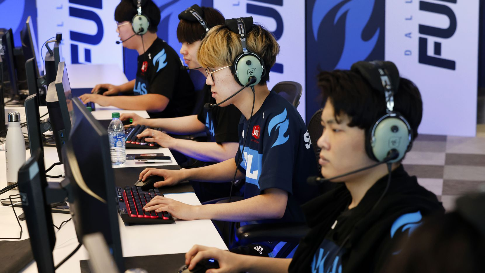 Dallas Fuel Overwatch League players (from left) Hanbeen 'Hanbin' Choi, Euiseok 'Fearless' Lee, Yeonghan 'SP9RK1E' Kim, and Gihyo 'XZI' Jung practice ahead of their season opener against Houston at Envy Gaming Headquarters in Dallas, Monday, March 29, 2021. (Tom Fox/The Dallas Morning News)