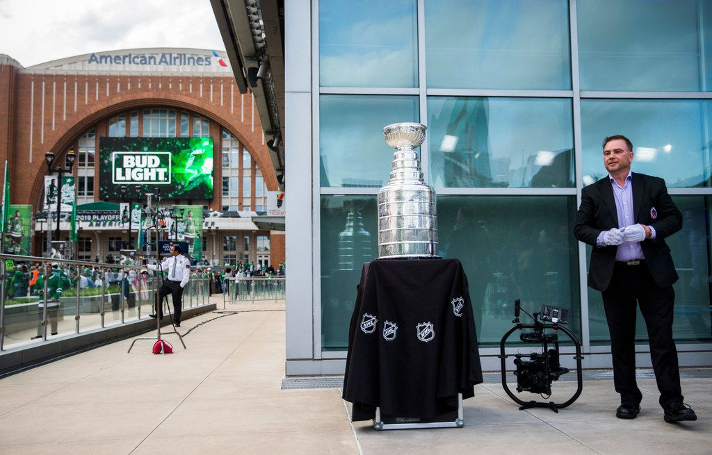 Stanley Cup keeper Howie Borrow (right) stands with the Stanley Cup outside American Airlines Center before Game 6 of the first round of Stanley Cup Playoffs between the Dallas Stars and the Nashville Predators on Monday, April 22, 2019 in Dallas. (Ashley Landis/The Dallas Morning News)